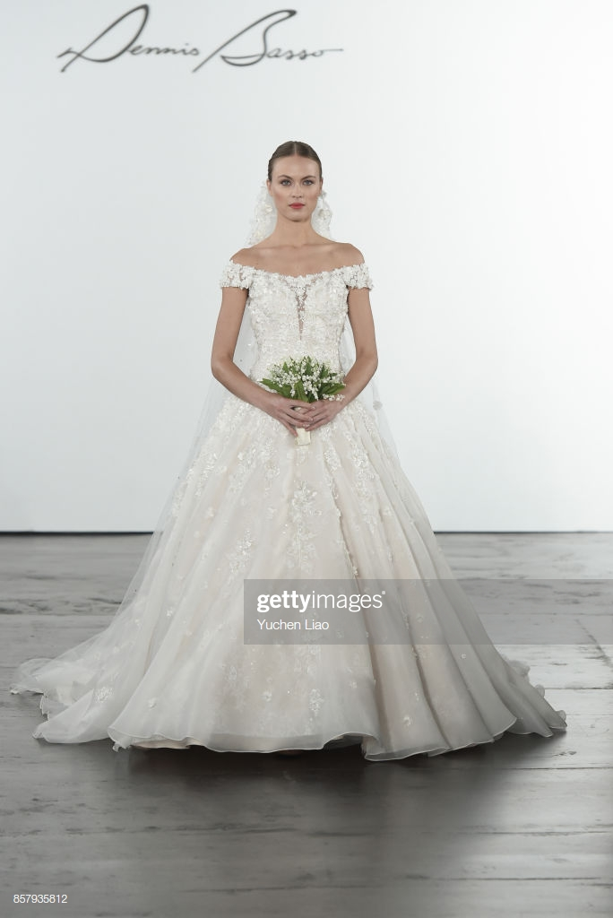 model walks the runway for dennis basso for kleinfeld bridal show picture id