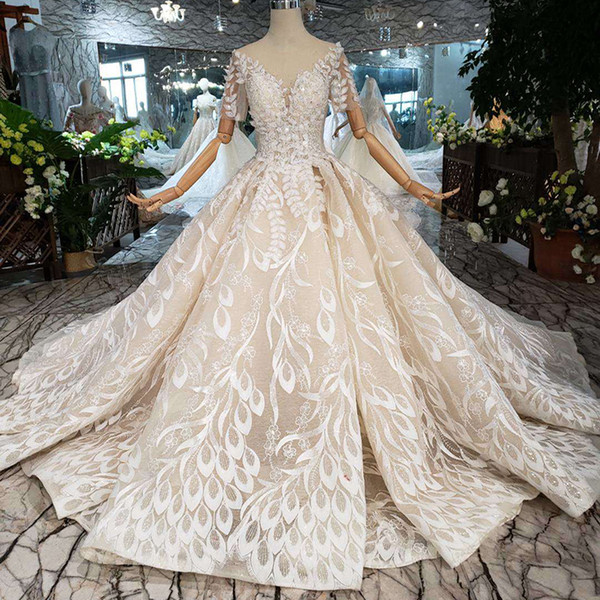 Lebanon Wedding Dresses Elegant 2019 Newest Design Lebanon Wedding Dresses Shining Crystal Tulle Short Sleeve Wedding Gowns Open Keyhole Back Exquisite Garden Bridal Gowns Knee