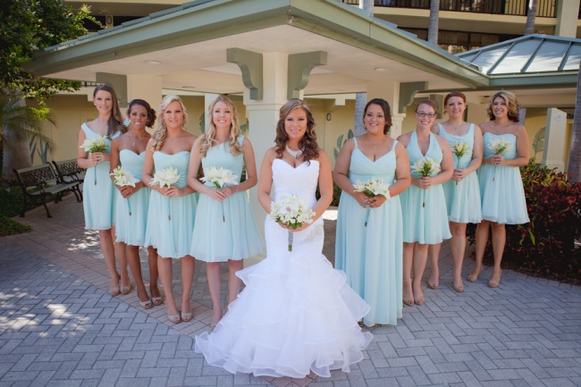 31 bride in mermaid shaped sweet heart neckline wedidng dress and bridesmails in teal color dresses at nautical themed wedding