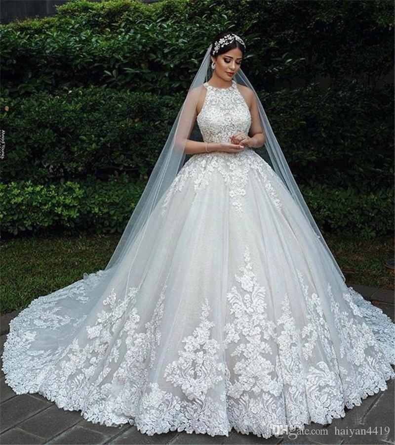 Plus Size Bling Wedding Dresses Luxury 2020 New Arabic Ball Gown Wedding Dresses Halter Neck Lace Appliques Beads Tulle Hollow Back Puffy Court Train Plus Size formal Bridal Gowns