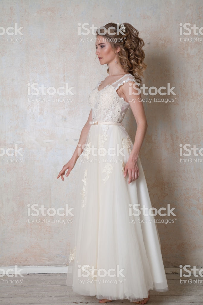 beautiful bride posing wedding hairstyle and dress vintage picture id