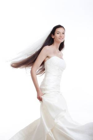 trendy wedding dresses beautiful portrait od a bride with long dark hair in wedding dress isolated