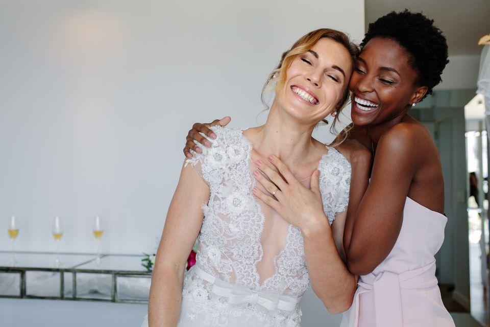 cheerful bride and bridesmaid on the wedding day 5af063b b81bcb