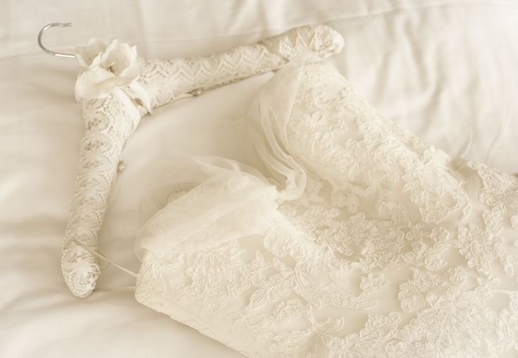 germany lace wedding dress lying on bed 587e5f263df78c17b691e913